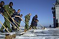 US Navy 020530-N-0111R-008 Sailors conduct a flight deck scrub exercise.jpg