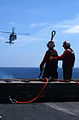 US Navy 030427-N-5781F-019 An SH-60 Seahawk hovers above flight deck aboard USS Kitty Hawk (CV 63), offloading ammunition to the ammunition ship USNS Flint (T-AE 32) during a vertical replenishment.jpg