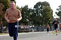 US Navy 040331-N-9712C-006 Construction Mechanic 1st Class Matthew Gerten, assigned to Naval Mobile Construction Battalion Four Zero (NMCB-40), finishes the one and half-mile run portion of the Navy Physical Readiness Test.jpg