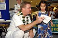 US Navy 040417-N-3019M-002 Rear Adm. Barry McCullough, Commander, Navy Region Hawaii, presents an award to one of the coloring contest winners as part of Earth Day celebrations.jpg