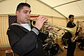US Navy 041215-N-3236B-010 Musician 3rd Class Jason Hanna, a Jazz trumpets in the Commander Sixth Fleet Jazz Ensemble, entertains World War II veterans, active duty Soldiers and Sailors during a luncheon honoring the liberatio.jpg