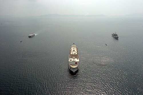 US Navy 050225-N-8629M-217 The High Speed Vessel Two (HSV 2) Swift, left, USNS Mercy (T-AH 19), center, and MSC supply ship USNS San Jose (T-AFS 7) shown operating in formation in the Indian Ocean