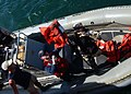 US Navy 050430-N-5526M-033 Sailors transfer men and women in a rigid hull inflatable boat after their boat, a fishing vessel, capsized 25 miles off the coast of Somalia.jpg