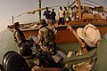 US Navy 050720-N-4309A-231 An Arabic translator assists in the language barrier between coalition forces and local fisherman in the Khawr Abd Allah (KAA) waterway during operation United River Dragon.jpg