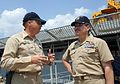 US Navy 050910-N-5526M-003 Master Chief Petty Officer of the Navy (MCPON) Terry Scott speaks with the Command Master Chief, USS Tortuga (LSD 46), Dewayne Burns in New Orleans.jpg
