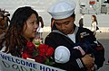 US Navy 051220-N-3925A-003 Operations Specialist 2nd Class Sherwin Mae greets his wife and daughter after returning from a five-month deployment aboard USS McClusky (FFG 41).jpg
