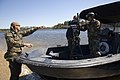 US Navy 061023-N-5319A-057 Sailors assigned to Naval Small Craft Instruction and Technical Training School (NAVSCIATTS) train personnel from the Iraqi Riverine Police Force on and weapon handling.jpg
