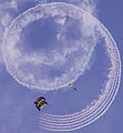 US Navy 070308-N-4163T-302 Members of the U.S. Navy Parachute Demonstration Team Leap Frogs descend into San Diego's Qualcomm Stadium trailing smoke grenade as part of a training session.jpg