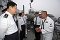 US Navy 070523-N-7883G-029 USS Stethem (DDG 63) Boatswain's Mate 3rd Class Allen Solis of San Diego, explains aspects of his job to Chinese North Sea Fleet Chief of Staff Rear Adm. Yongqing Zhao and his staff from the People's.jpg