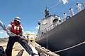 US Navy 070529-N-4965F-002 Hospitalman Justin Frasier, assigned to Arleigh Burke-class guided-missile destroyer USS Hopper (DDG 70), performs line handlers for Japan Maritime Self Defense Force (JMSDF) ship JDS Chokai (DDG 176).jpg