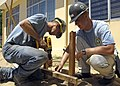 US Navy 070717-N-4954I-101 Steelworker 3rd Class Joseph Fleming and Equipment Operator Constructionman Ryan Cofer prepare footers for a playground kit to be installed on the campus of Hoi Mai Orphanage.jpg
