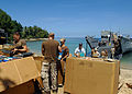 US Navy 070823-N-4954I-117 Seabees attached to Amphibious Construction Battalion (ACB) 1, unload Project Handclasp supplies from Landing Craft Unit (LCU) 1665.jpg