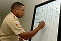 US Navy 070910-N-0989H-020 A Dominican port security officer prepares to present a risk analysis matrix for response to hurricanes, during port security training.jpg