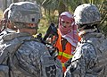 US Navy 071209-N-1132M-042 An local citizen led U.S. Army Soldiers with 2nd Platoon, Able Company, 4th Battalion, 9th Infantry Regiment, 4th Stryker Brigade Combat Team, 2nd Infantry Division to the site of unexploded improvise.jpg