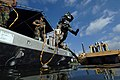 US Navy 080619-N-5329L-039 Navy Diver 3rd Class Kevin Vagaski, attached to Mobile Diving and Salvage Unit (MDSU) 2, leaps into the cold and murky waters of the Providence River during a dive on the sunken former Soviet submarin.jpg
