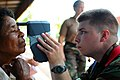 US Navy 080809-N-4515N-122 Hospitalman Michael Hagslund, assigned to the medical department of the amphibious assault ship USS Kearsarge (LHD 3), examines a Nicaraguan citizen for cataracts during a Continuing Promise 2008 medi.jpg