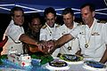 US Navy 080831-N-4128S-190 Capt. William Kearns, Capt. James Rice, Vice Adm. John Bird, Chuuk State Governor Wesley Simina and Capt. Robert Wiley pose during a cake cutting ceremony aboard Mercy during its farewell reception in.jpg