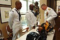 US Navy 080918-N-8273J-225 Chief of Naval Operations (CNO) Adm. Gary Roughead speaks with Navy Diver 1st Class Michael Celestine about the helmets Navy divers use while conducting maintenance on ships.jpg