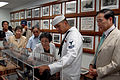US Navy 081006-N-5174T-007 Boatswain's Mate 2nd Class Joe Mendoza describes the Dec. 7, 1941 Japanese attack on the battleship USS Arizona during a tour of the Battleship Arizona Memorial for Tamio Mori, right, mayor of Nagaoka.jpg