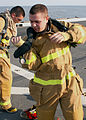 US Navy 081214-N-6423H-067 Interior Communications Specialist 2nd Class Michael Parliament dons a firefighting ensemble during a damage control Olympics aboard the amphibious transport dock ship USS San Antonio (LPD 17).jpg
