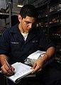 US Navy 090120-N-2908M-001 Storekeeper Seaman Serafin Maldonado records and stores parts aboard the aircraft carrier USS Theodore Roosevelt (CVN 71).jpg