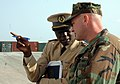 US Navy 090204-N-1655H-127 Chief Engineman Edward Young speaks with an African naval officer.jpg