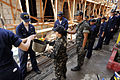 US Navy 090221-N-8546L-385 Sailors embarked aboard the amphibious command ship USS Blue Ridge (LCC 19) work with members of the Armed Forces of the Philippines Navy to transfer concrete.jpg
