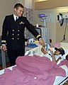 US Navy 090305-N-9599T-001 Lt. Andrew Baldwin, M.D. visits a patient at St Joseph's Hospital and Medical Center.jpg