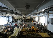 US Navy 090529-N-1062H-042 Supply and deck department Sailors transfer cargo in the hangar bay of the aircraft carrier USS George Washington (CVN 73) during a replenishment-at-sea