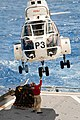 US Navy 090618-N-9689V-006 Embarked Presidential Airways Puma Vertical Takeoff and Replenishment Team practice maneuvers aboard the Military Sealift Command dry cargo-ammunition ship USNS Richard E. Byrd (T-AKE 4) in preparatio.jpg