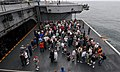 US Navy 090718-N-2844S-002 Sailors with their friends and family, ride on aircraft elevator two from the flight deck to the hangar bay on board the aircraft carrier USS Harry S. Truman (CVN 75).jpg