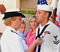 US Navy 091002-N-6326B-010 Rear Adm. Christine M. Bruzek-Kohler, commander of Naval Medical Center San Diego, presents the Bronze Star medal to Hospital Corpsman 2nd Class Phillip A. Azevedo.jpg