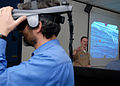 US Navy 100218-N-5096L-144 Adam Hecht, an assistant professor at the University of New Mexico, uses the Virtual Environment Submarine Trainer during an educator orientation visit at Submarine Learning Center Detachment San Dieg.jpg