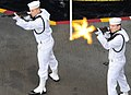 US Navy 100725-N-7422B-269 Aviation Boatswain's Mate (Handling) Airman Apprentice Derek Elswick, left, and Aviation Ordnanceman 2nd Class Shane R. Kennedy conduct a 3-volley salute during a burial at sea aboard USS Carl Vinson.jpg