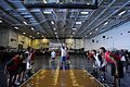 US Navy 100911-N-7605J-097 nterior Communications Electrician 3rd Class Ricky Darden shoots a free throw during a basketball game in the hangar bay.jpg