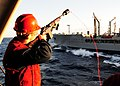 US Navy 101127-N-0939H-077 Airman Sean Nugent shoots a shot-line to the Military Sealift Command's Fleet Replenishment Oiler USNS Tippecanoe (T-AO.jpg