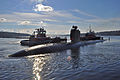 US Navy 101218-N-7516W-307 Two tugboats push USS Alexandria (SSN 757) into port at Naval Submarine Base New London.jpg