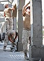 US Navy 110112-N-4440L-009 Seabees apply stucco to the exterior columns of the Ecole 5 primary school construction project.jpg