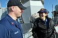 US Navy 110203-N-9818V-077 Sonar Technician (Surface) 1st Class Joseph Whalen speaks with Japan Maritime Self-Defense Force Signalman 3rd Class Rik.jpg