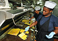 US Navy 110508-N-1004S-090 Culinary Specialist 3rd Class Maisha Dublin and Culinary Specialist Seaman Christina Clayton cook omelets as part of a S.jpg