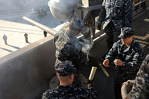 US Navy 111219-N-AU622-038 Gunner's Mate Seaman Apprentice Giacobino Imperiale prepares to load ammunition as Gunner's Mate 3rd Class Antoine Willi.jpg