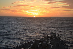 US Navy 120120-N-NG317-001 The sun sets over the guided-missile destroyer USS Milius (DDG 69) while transiting the Pacific Ocean.jpg