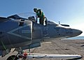 US Navy 120130-N-OR551-061 A Sailor cleans the cabin of an aircraft.jpg