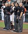 Umpires standing for National Anthem (15049573755).jpg