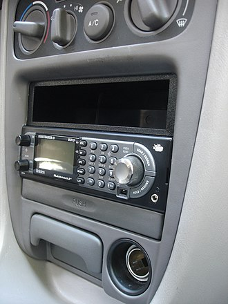 Radio scanner - New York State and Florida currently prohibit scanners installed in a vehicle unless the operator has an FCC issued radio license