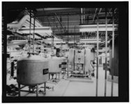 VIEW OF SECOND FLOOR, SOUTHERN PORTION OF BUILDING 707. THE STORAGE TANKS CONTAIN MACHINE COOLANTS AND SOLVENTS USED IN FABRICATION PROCESSES. (5-70) - Rocky Flats Plant, HAER COLO,30-GOLD.V,1M-19.tif