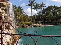 Venetian pool with waterfall and palms at Coral Gables, Miami.jpg