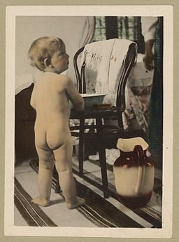 Vintage Picture of a Cute Baby Boy About to Wash Himself with a Basin and Pitcher of Water