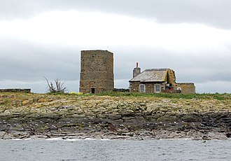Farne Islands - Site of the former lighthouse on Brownsman Island (1811–26): its base remains attached to the right of the keeper's cottage. Earlier, a light used to be shown from the tower on the left.