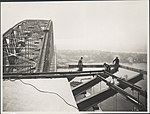 Workmen attaching the supports to a pylon of the Sydney Harbour Bridge, 1932 (8282687063).jpg